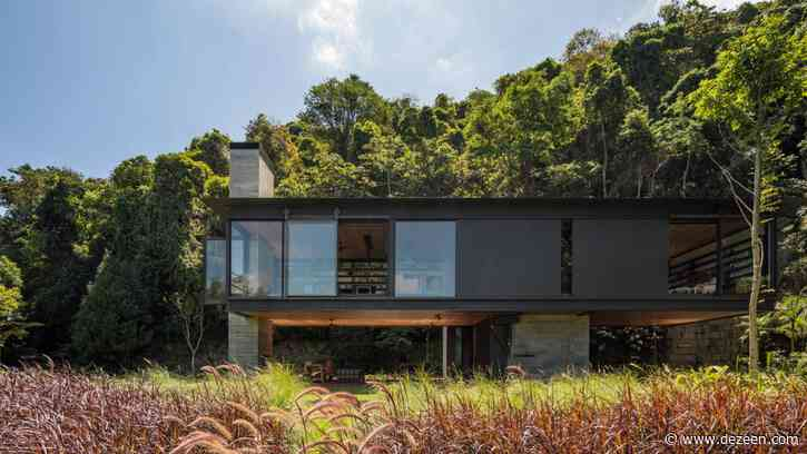 Olson Kundig Rio House is elevated on chunky concrete columns in Brazilian rainforest