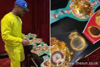 Floyd Mayweather shows off incredible world title belt collection as boxing legend jumps on private jet with - The Sun