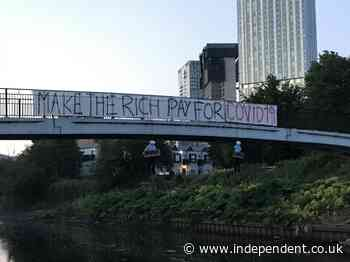 'Make the rich pay for Covid-19': Effigies of Dominic Cummings and Sir Richard Branson hung from Salford bridge