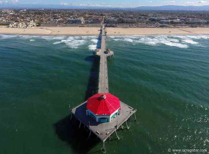 Iconic Huntington Beach Pier reopens to public, but keep moving