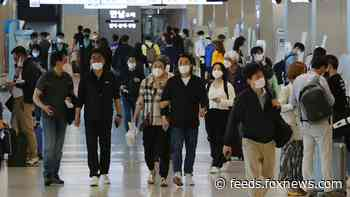 South Korea restores coronavirus lockdown restrictions after new spike in cases