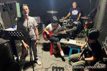 As China's factories feel economic blues, band of workers tell their story through rock music