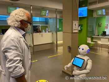 Robot helpt patiënten UZ met naleven van coronamaatregelen - Het Nieuwsblad