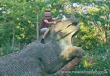 Men caught in picture climbing Crystal Palace Dinos