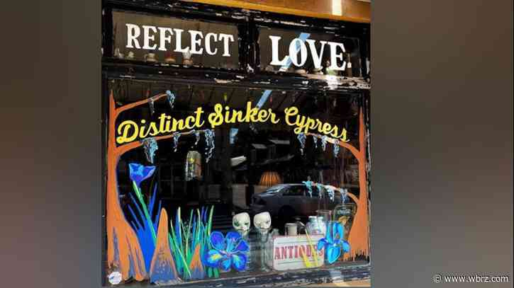 "Local artist paints storefronts with positive messages for ""Reflect Love"" initiative"