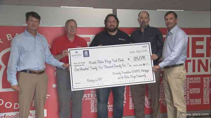 GBR Food Bank gets $125K check from Guaranty Media, GMFS Mortgage
