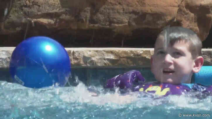 Family fights with HOA over water slide built for immunocompromised son