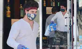 Aaron Taylor-Johnson wears a face mask, gloves and a bandana as he stocks up on beer and ice - Daily Mail