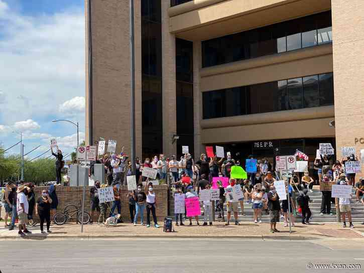 Protesters gather outside APD HQ after nine arrested during overnight demonstration