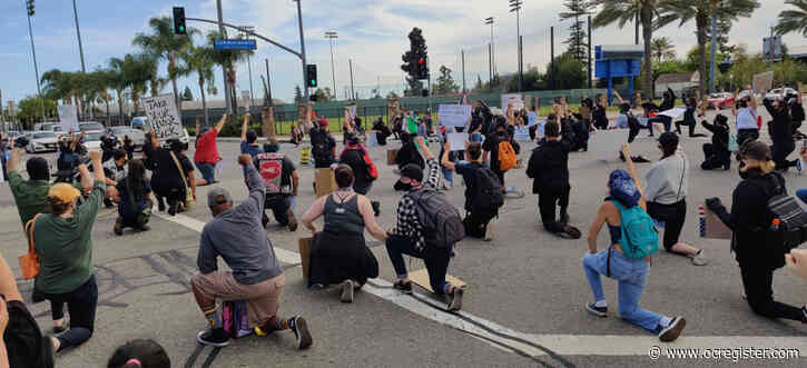 Peaceful day of protests in Orange County leads to uneasy night