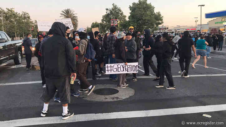 Protesters in Santa Ana throw rocks, fireworks and explosives at police, officers declare an unlawful assembly