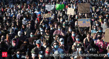 Tear gas and burning cars in US cities as unrest continues - Economic Times