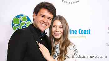 Bindi Irwin and husband Chandler Powell explain how their honeymoon has been 'slightly crazy'