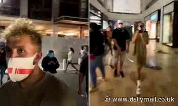 Youtube star Jake Paul faces criticism after he's spotted among looters vandalizing an Arizona mall