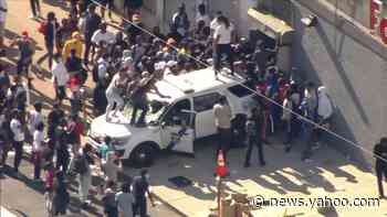 Chopper 6 over West Philly where looters damage police SUV