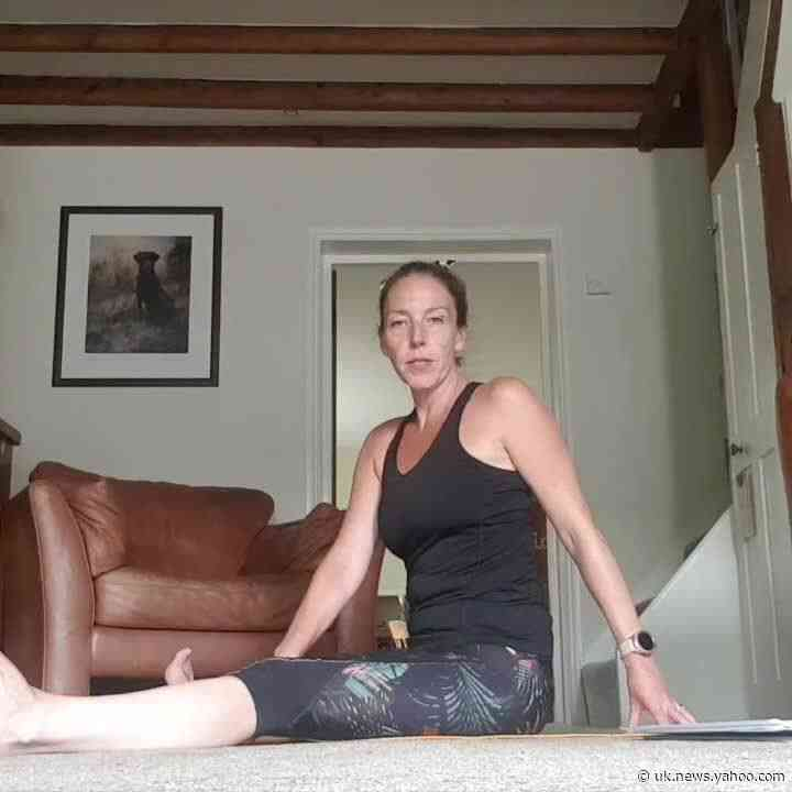 Yoga teacher giggles as dog rudely interrupts session