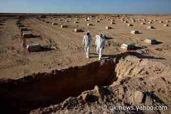 Iraqi militiamen drop guns to dig graves for coronavirus victims