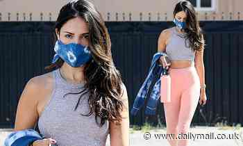 Eiza Gonzalez flashes her rock hard abs following a workout session with her trainer in Los Angeles