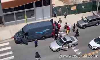 Terrifying moment crowd of looters raid an Amazon delivery van in broad daylight in Santa Monica