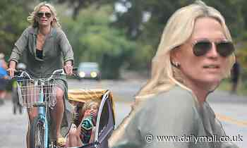 Molly Sims looks like she has her hands full as she takes her three kids to the beach