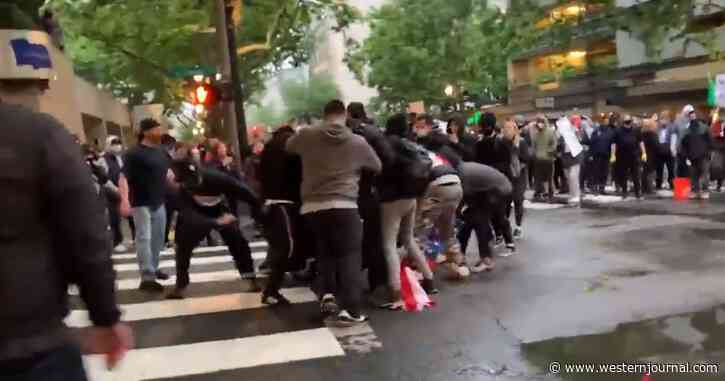 Watch: Man Refuses To Let Go of American Flag as He Is Viciously Attacked by Rioters