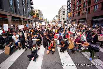 Thousands of protest marchers fill Hollywood's streets - LA Daily News