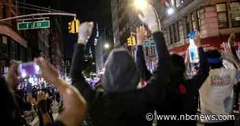 NYPD officer appears to brandish gun at protesters in video