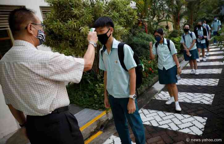 Schools reopen as Singapore eases lockdown restrictions