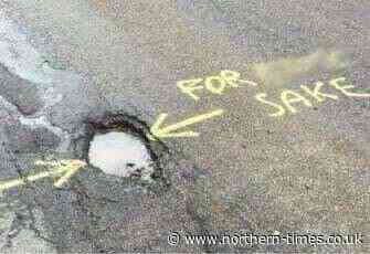 Disgruntled spray painter makes feelings know about potholes on north roads - Northern Times
