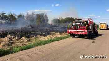 Firefighters battle brush fire next to Saskatoon airport