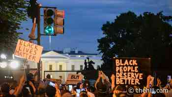 Unidentified military personnel extend perimeter around the White House