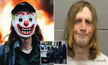 Rioter wearing Joker mask is arrested for torching Chicago cop car