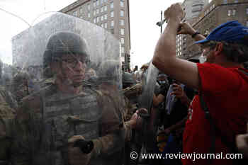 Washington protests peaceful amid show of force