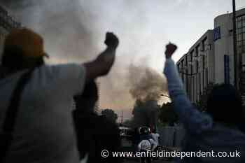 Paris police fire tear gas as George Floyd protests go global - Enfield Independent