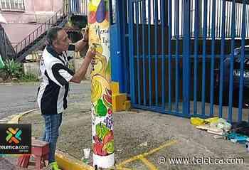 Vecino pinta postes para embellecer la comunidad en Ipís de Goicoechea - Teletica
