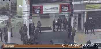 Suspeitos morrem em assalto a banco com tiroteio e refém em SP; PM é ferido - UOL Notícias