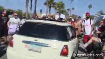 Car Speeds Through Crowd of Newport Beach Protesters, Driver Arrested