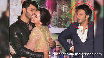 Blast from the past! Arjun Kapoor planting a kiss on Deepika Padukone's cheek as Ranveer Singh gives jealous boyfriend expression is just unmissable