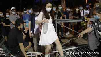 Hong Kong: Tens of thousands defy ban to attend Tiananmen vigil