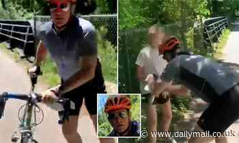 Police search for cyclist caught on video assaulting group putting up George Floyd posters