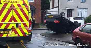 Two taken to hospital after VW Golf flips on to roof in Dudley