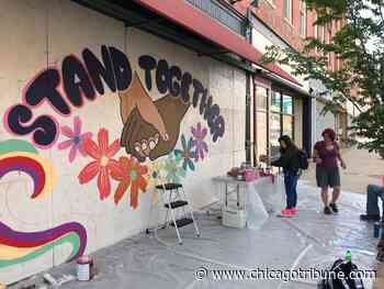 Artists continue work to beautify downtown Aurora after Sunday's damage - Chicago Tribune