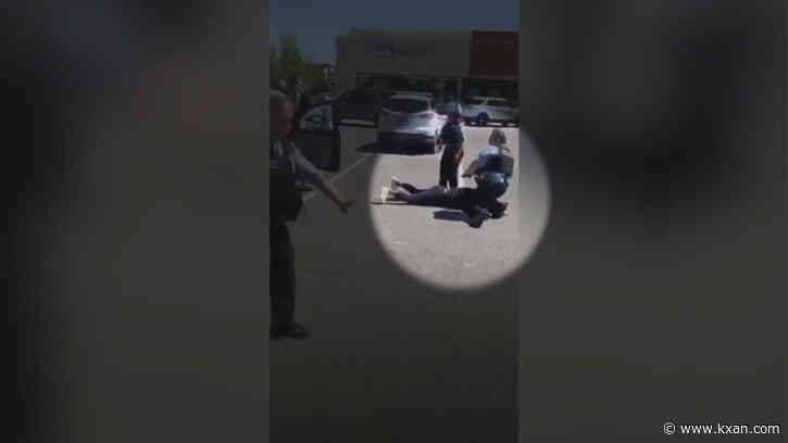 Video shows police officer placing knee on woman's neck in mall parking lot