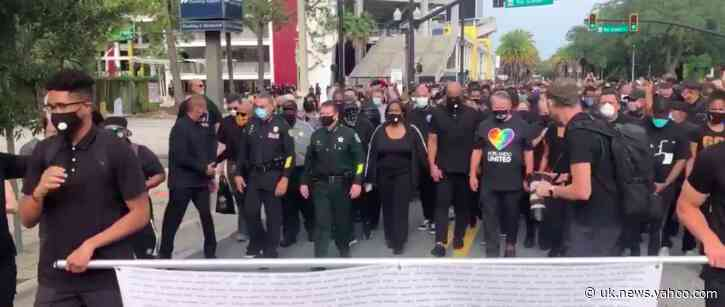 Orange County Sheriff and Officers Join 'A Walk of Mourning and Restoration' in Orlando, Florida