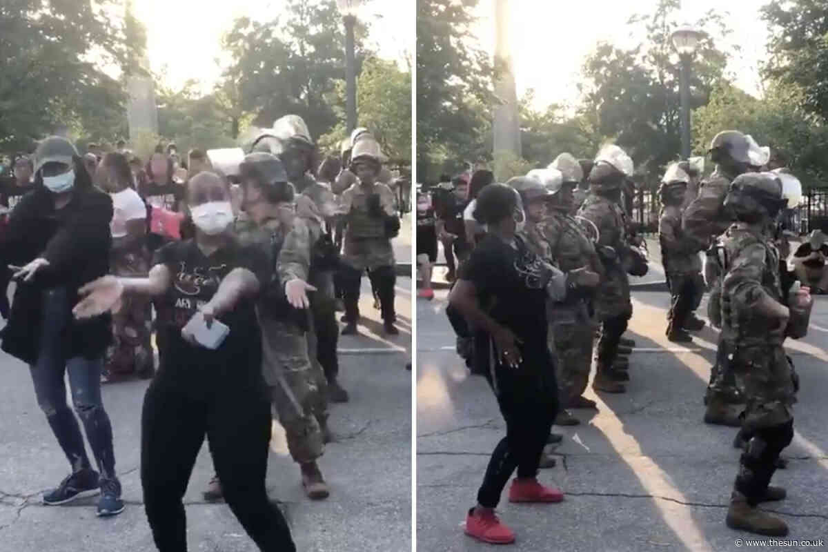 National Guard soldiers join protesters in MACARENA dance-off just minutes before curfew in Atlanta - The Sun