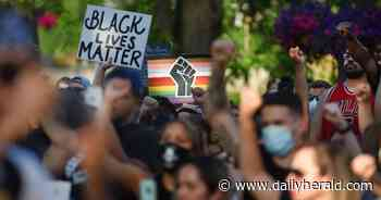 At peaceful march to Elgin City Hall on Friday, Decynthia Clements' father speaks