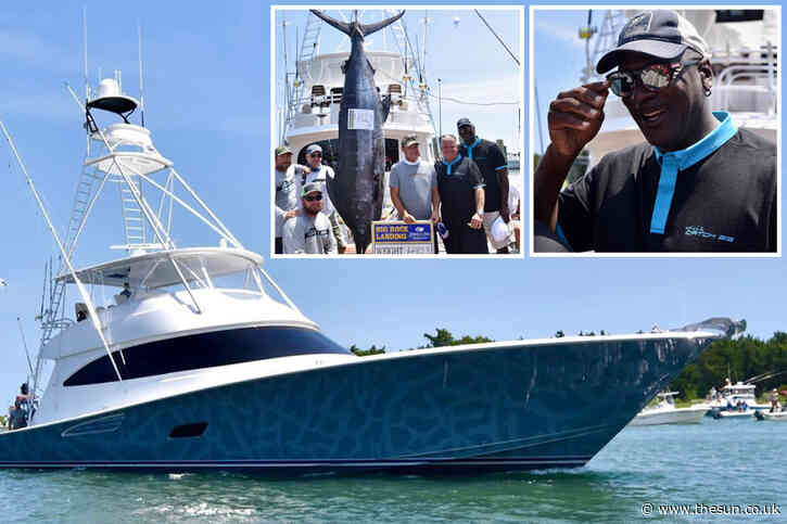 Michael Jordan catches monster 201kg blue marlin while sailing seas on his £6m yacht 'Catch 23' in fishing competition