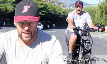 Adam Sandler enjoys bike ride in sunny Malibu as he continues to self-isolate at home with family - Daily Mail
