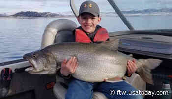 Boy, 10, lands huge lake trout like an old pro - For The Win