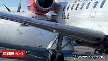 Planes wedged together after collision at Aberdeen Airport